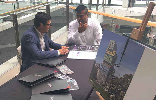 Location Property Group Director Speaking to a client